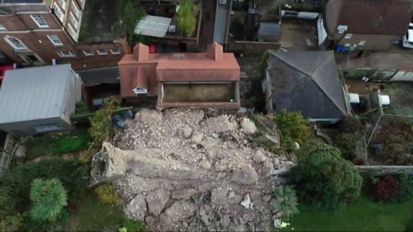 Medieval castle partially collapses on a house in England